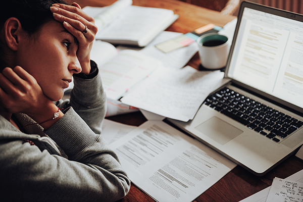 Frustrated woman working at laptop