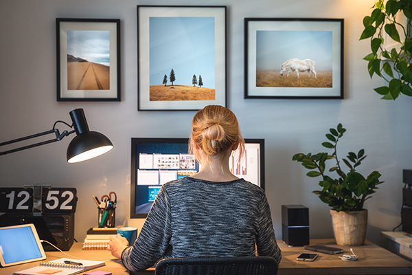 Woman working on computer in her home office.