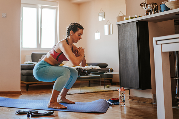 Young woman doing home exercise in the living room