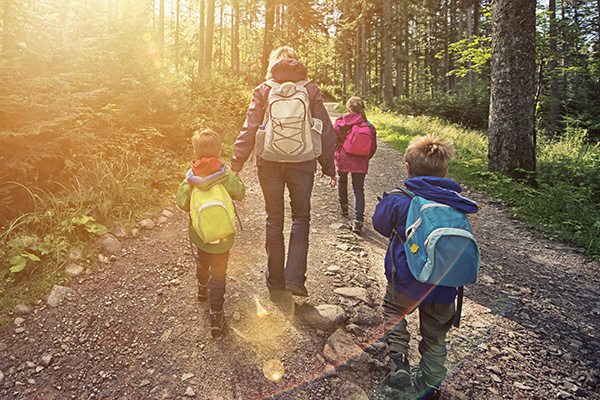 Mom and kids hiking in the woods