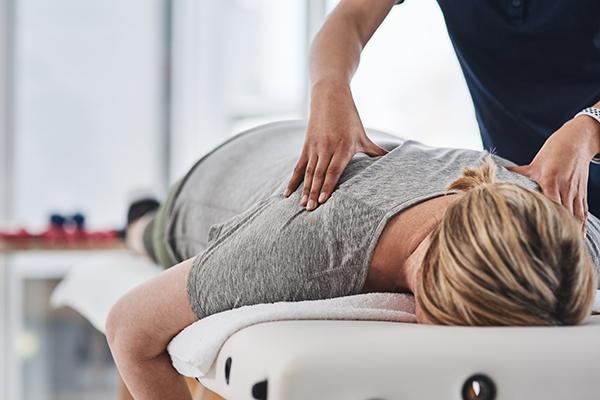 Woman getting professional back massage