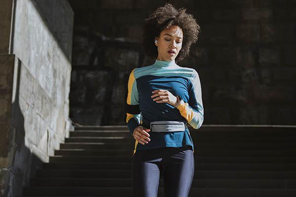 Female runner wearing running belt