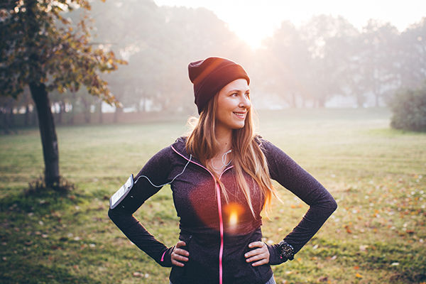 Woman feeling strong and fit after running outside