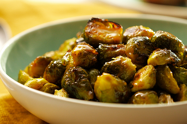 FIXATE-Maple-Glazed-Brussels-Sprouts in a bowl