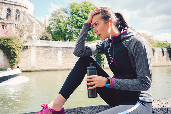 Runner taking a break with water bottle