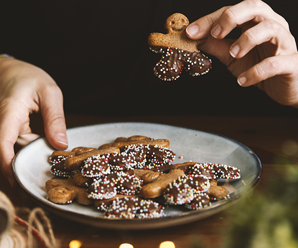 A plate of holiday gingerbread cookies