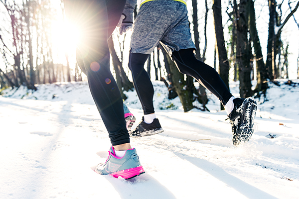 Couple going for a run in winter