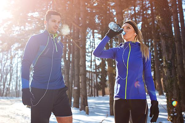 Couple running in winter