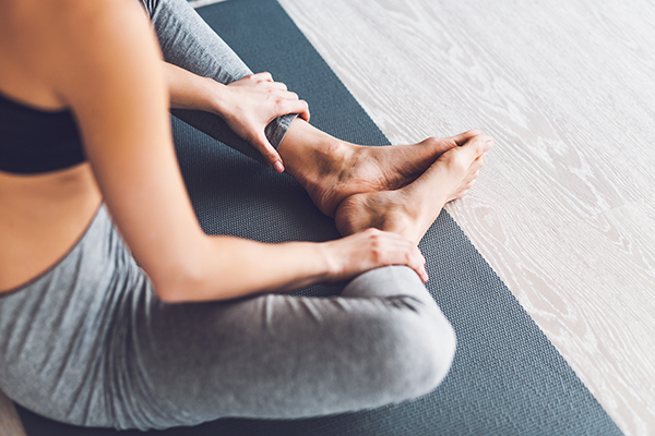 Close up of woman's legs in a yoga position