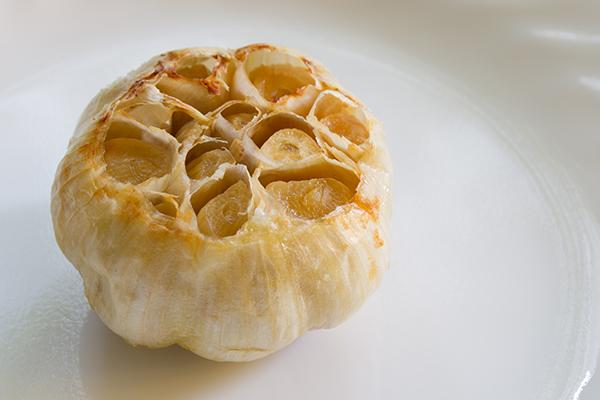 Close up of fresh roasted garlic bulb