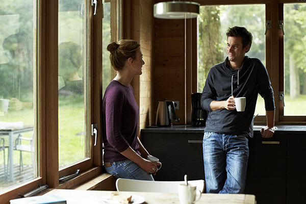 Couple having coffee at home together