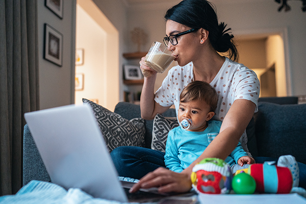 Mom multitasking work and childcare