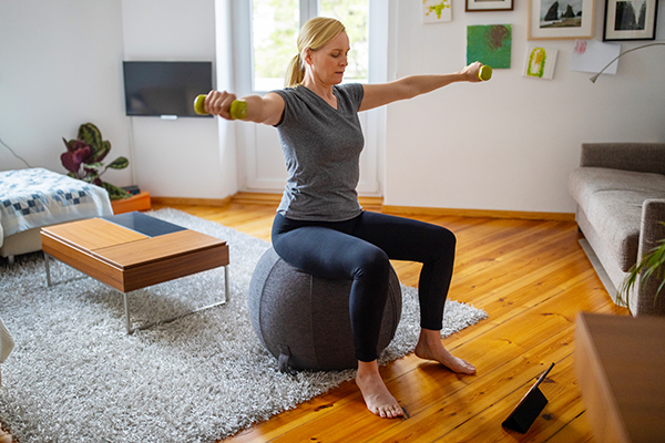 Woman doing streaming workout at home