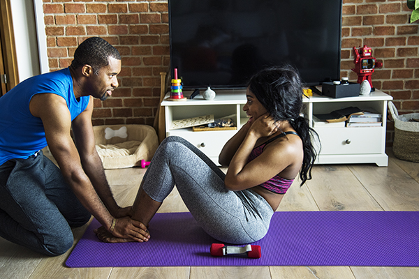 Couple at home working out together