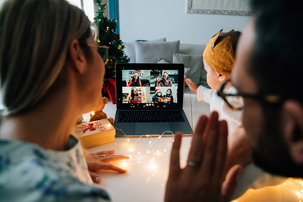 Family celebrating with relatives on Zoom call