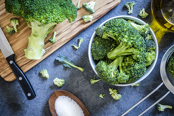 Overhead photo of broccoli stems in a bowl