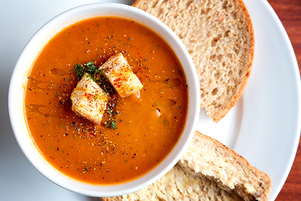 Tomato soup garnished with croutons and parsley