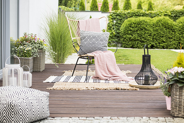 Chair, blanket, pillow on chair outdoors