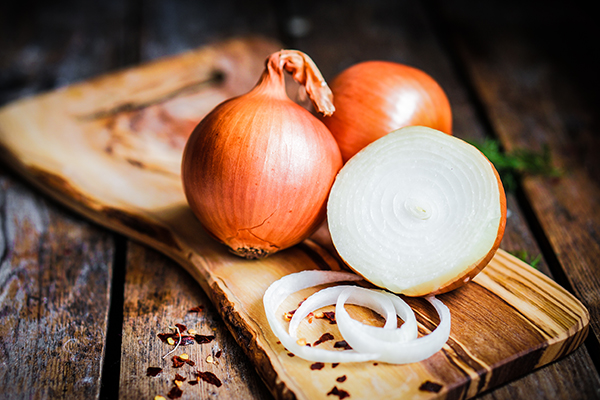Onions on rustic wooden background