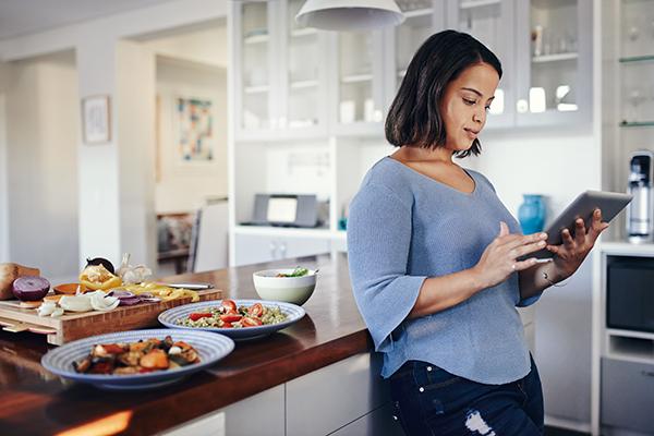 Woman in kitchen preparing meals