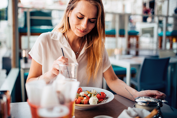 Woman eating Mediterranean food