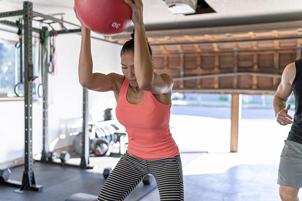 Woman doing medicine ball slams
