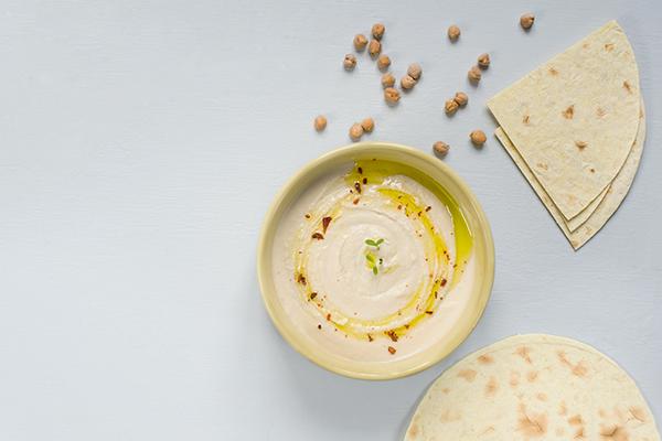Bowl of hummus and tortillas