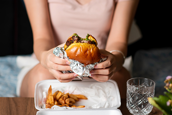 Woman eating burger and fries