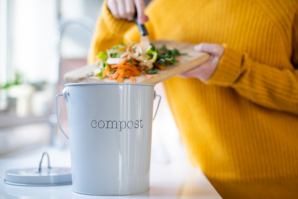 Woman Making Compost From Vegetable Scraps