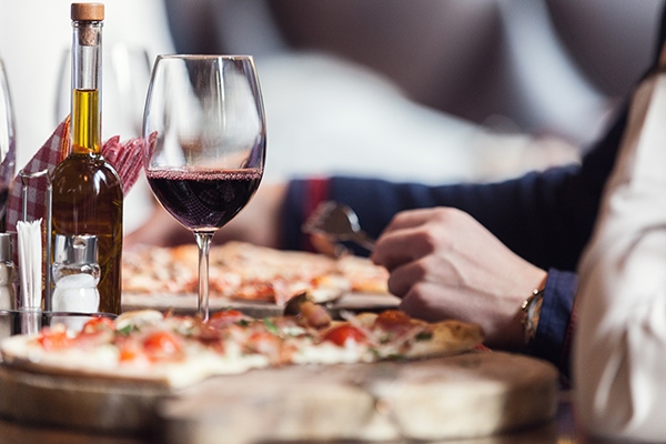 Drinking red wine with pizza