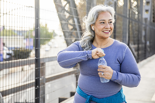 Woman drinking water after a workout.