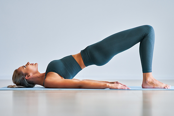 Woman performing glute bridge