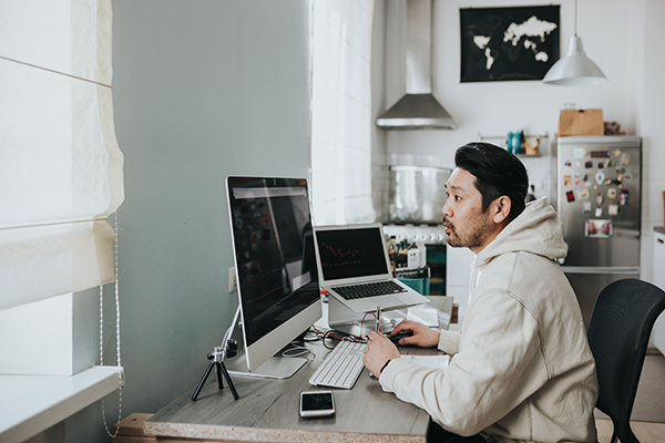 Man sitting at computer working from home