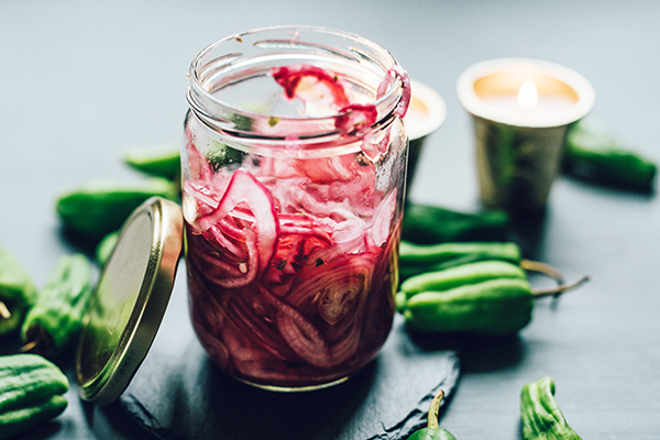 Pickled red onion in a jar