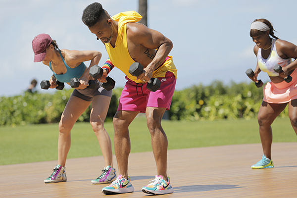Shaun T doing bent-over row on LET'S GET UP! set
