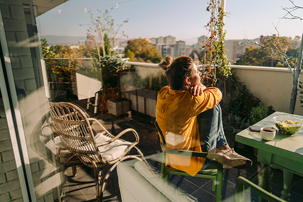 Woman relaxing outdoor on patio.