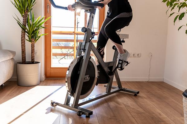 Woman riding indoor bike
