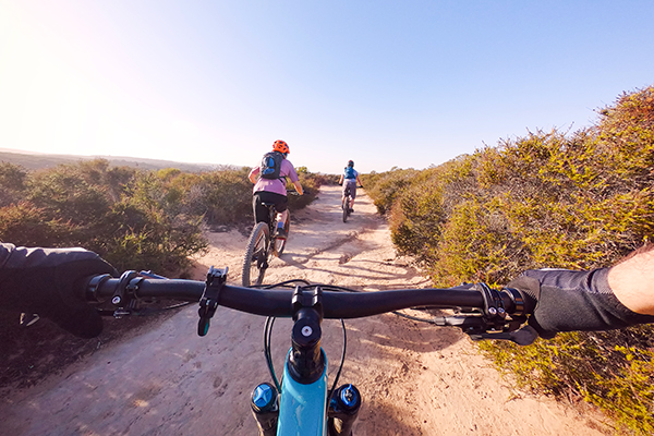 POV of person riding a bike outdoors on trail