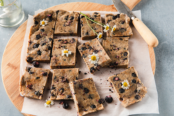 Shakeology No Bake Blueberry Pie Bars on a cutting board