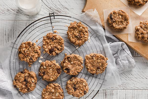 Shakeology No Bake Oatmeal Raisin Cookies on a wire rack