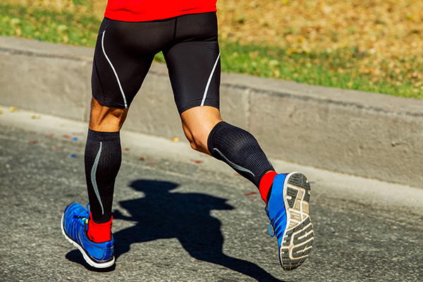 Male runner wearing compression socks