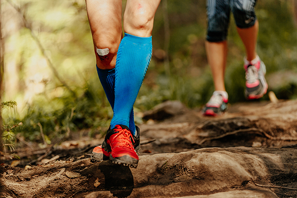 Female runner wearing blue compression socks