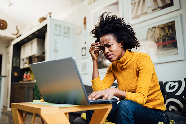 Stressed out woman looking at her computer