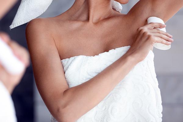 Woman applying natural deodorant