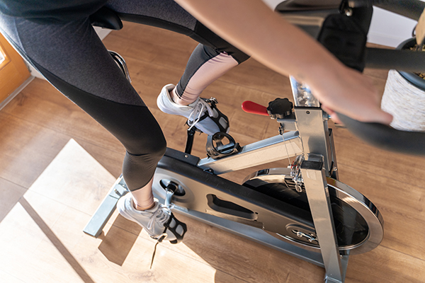 Woman exercising at home on indoor bike
