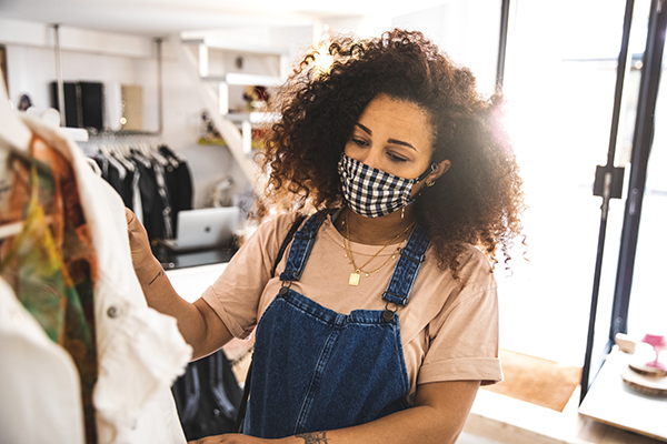 Woman shopping with mask on, post pandemic