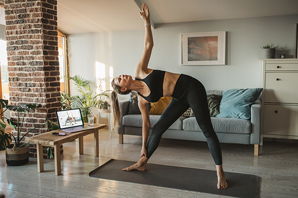 Woman at home doing online workout