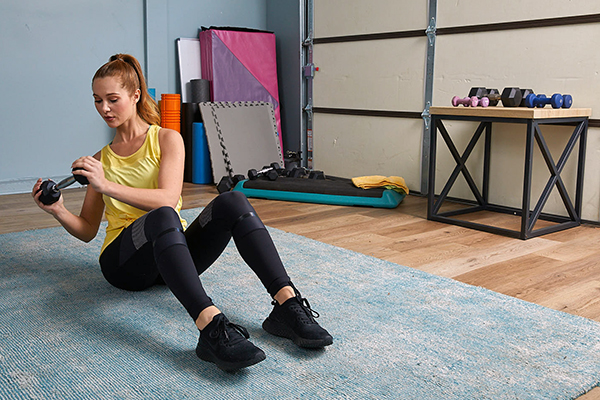 Woman doing workout in home gym