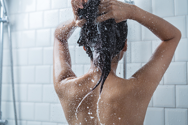 Woman washing her hair in shower