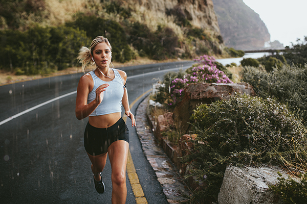 Woman doing interval running on road